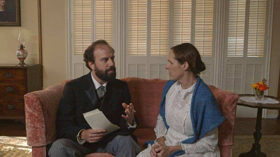 Higginson (Brett Gelman) takes a knife to Emily's (Molly Shannon) poems - WILD NIGHTS WITH EMILY - Courtesy of Greenwich Entertainment